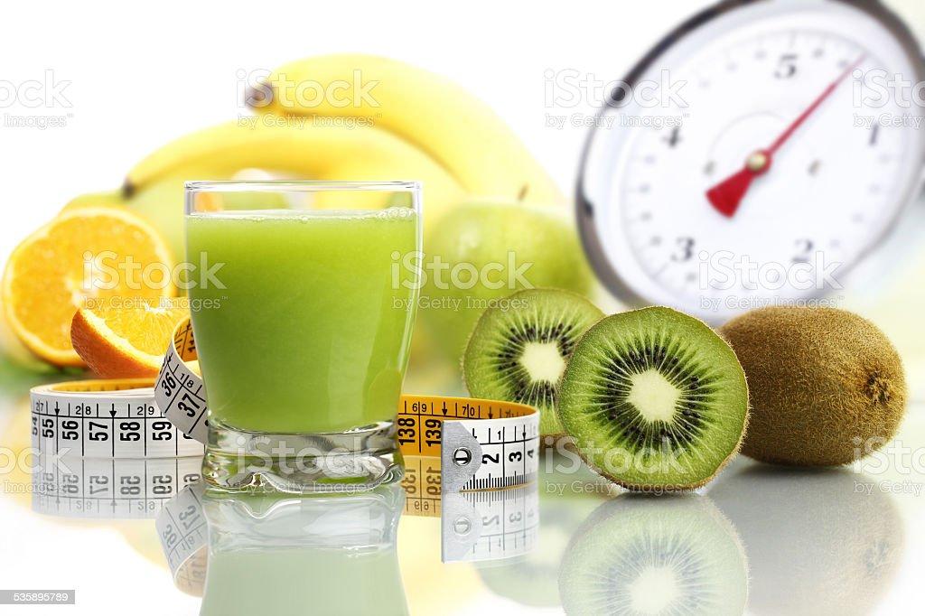 kiwi juice in glass, fruit meter scales diet food stock photo