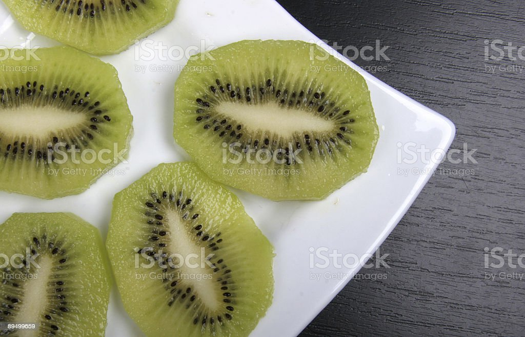 kiwi on plate royaltyfri bildbanksbilder