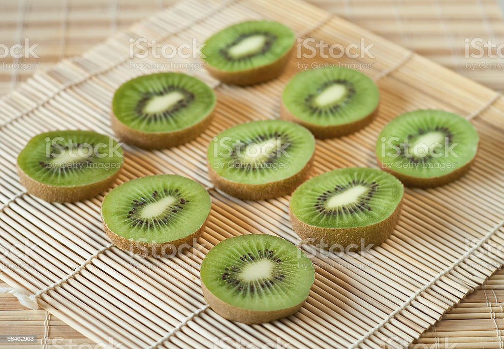 Kiwi slices in rows royalty-free stock photo