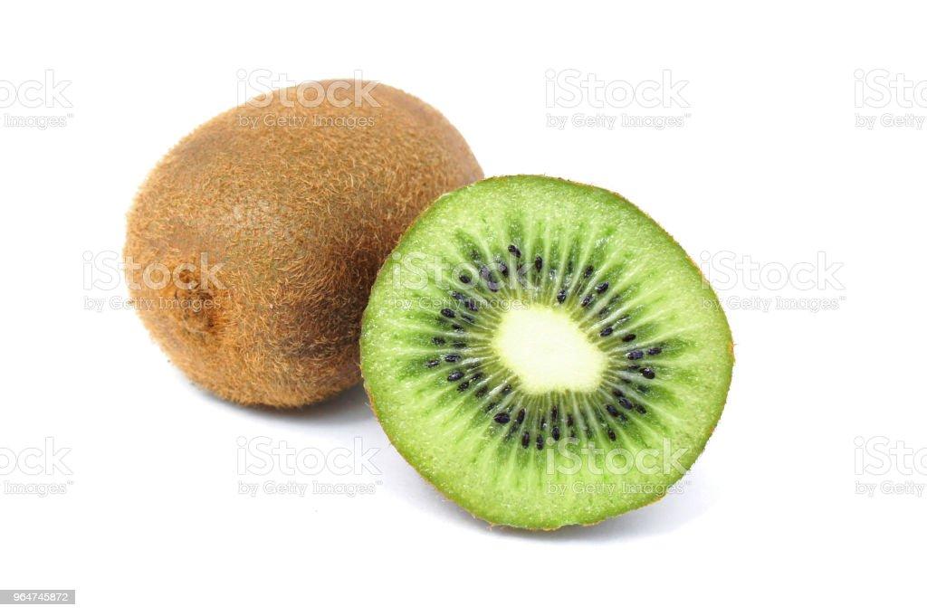 Kiwi whole and half on a white background royalty-free stock photo