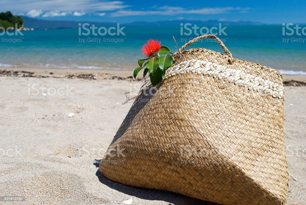 Kiwiana Summer or Christmas Background, Flax Kete on Beach stock photo