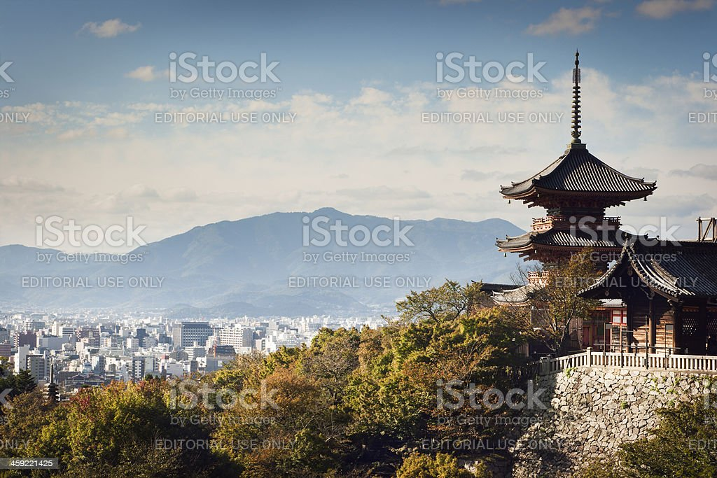 Kiyomizu-dera Temple Buildings with Kyoto, Japan City Skyline and Mountains stock photo