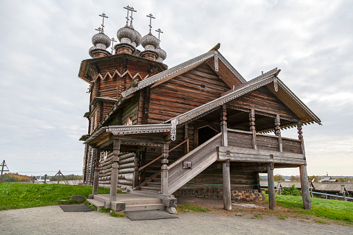 Kizhi island, Onega lake, Karelia, Russia.  In the foreground Orthodox Church of the Intercession of the Virgin in Kizhi Pogost.