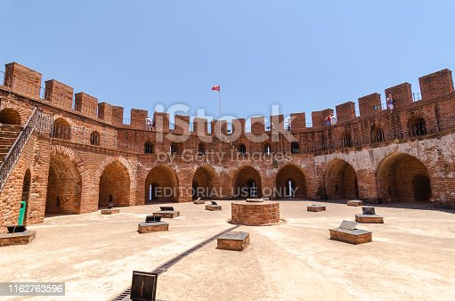 Alanya,Antalya,TURKEY-June 25 , 2019: Walls of the Kizil(red)  tower and and the highest point.Tourists are taking photos of the city from the Kizil (red) tower.