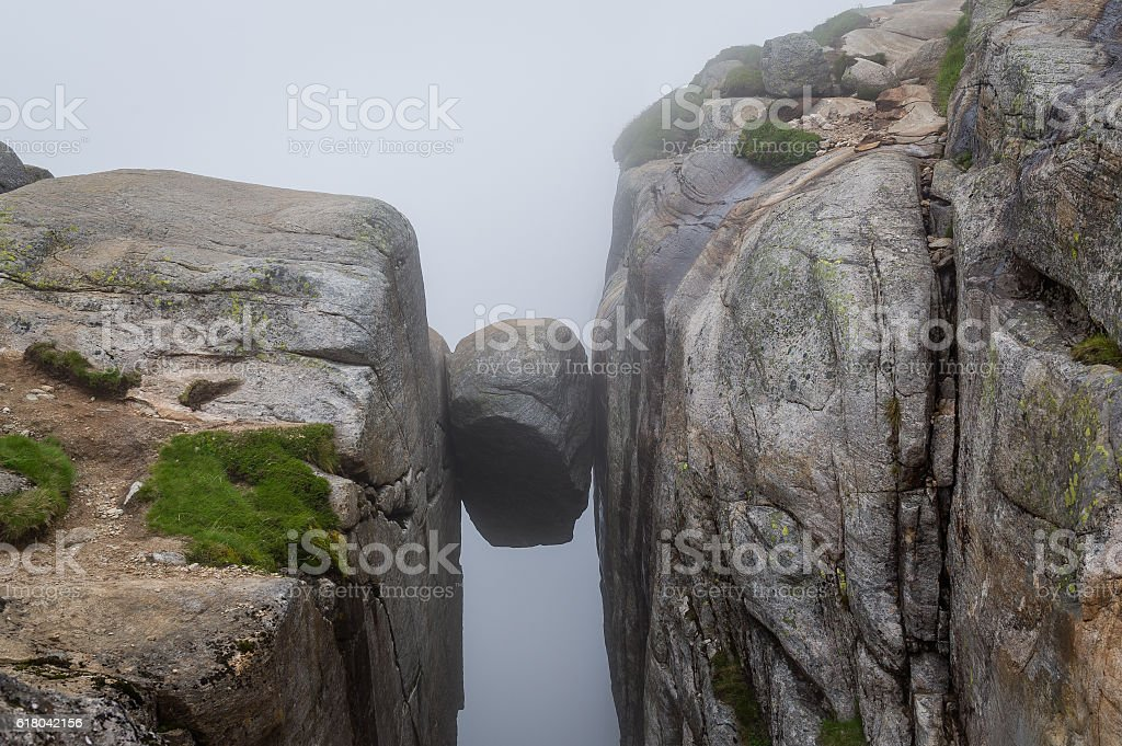 Kjerag stone, hanging on the cliff between two high rocks. stock photo
