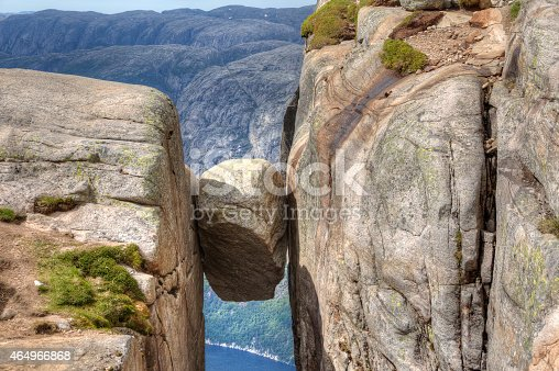 A big stone that was wedged between two mountain sides in Lysefjorden during the ice age, Rogaland, Norway. Famous tourist attraction. People usually go out on this to get their picture taken. It hangs 1000 m above Lysefjorden