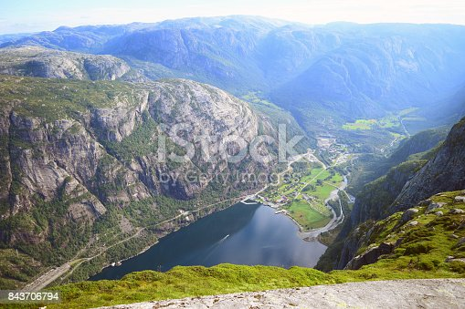 Kjeragbolten the popular place in Norway, People enjoy the trip to the top of the mountain in the summer enjoy day with the sun nice blue sky. nice to hiking and enjoy the norwegain landscape.
