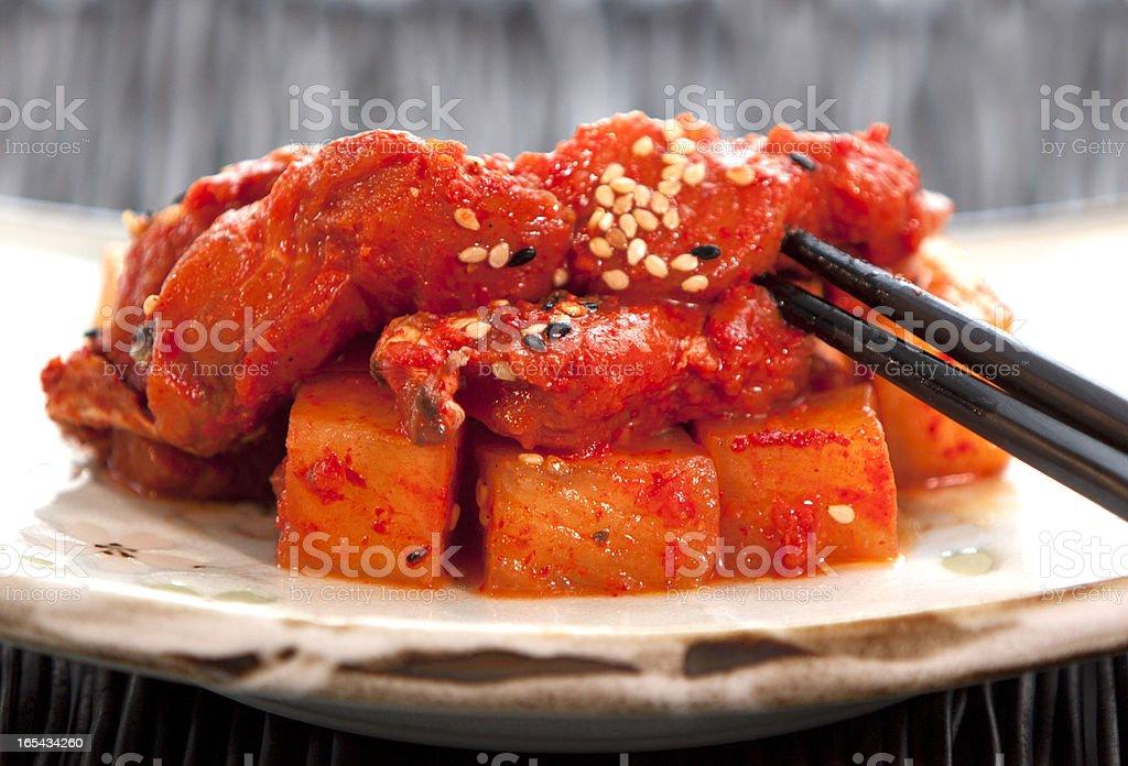 Kkakdugi with Fish and Chopsticks royalty-free stock photo