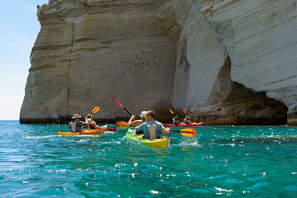 Kleftiko rock formations kayaking Melos, Greece stock photo