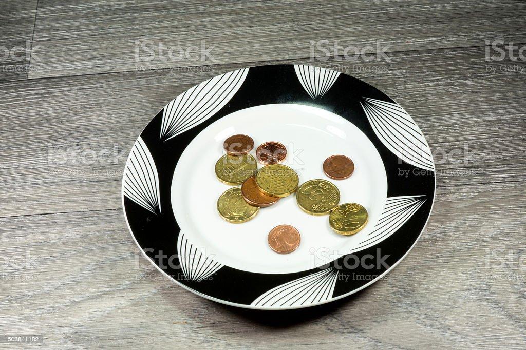 Kleingeld und Teller stock photo