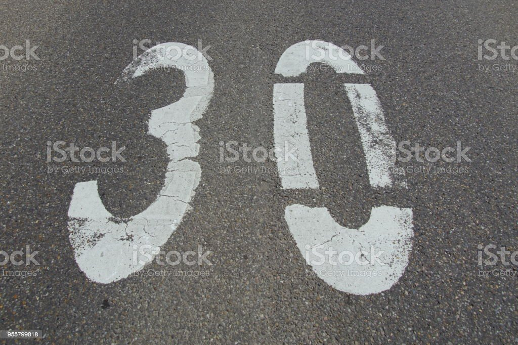 30 km road marking speedlimit stock photo