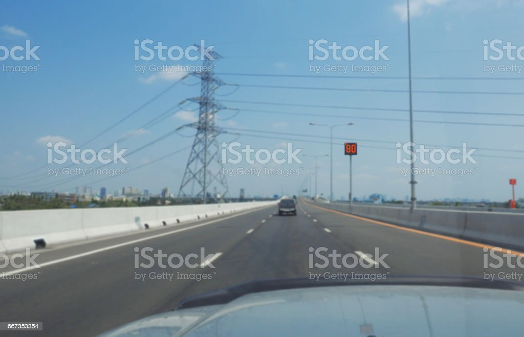 80 km/h speed limit sign on a blur express way background - Photo