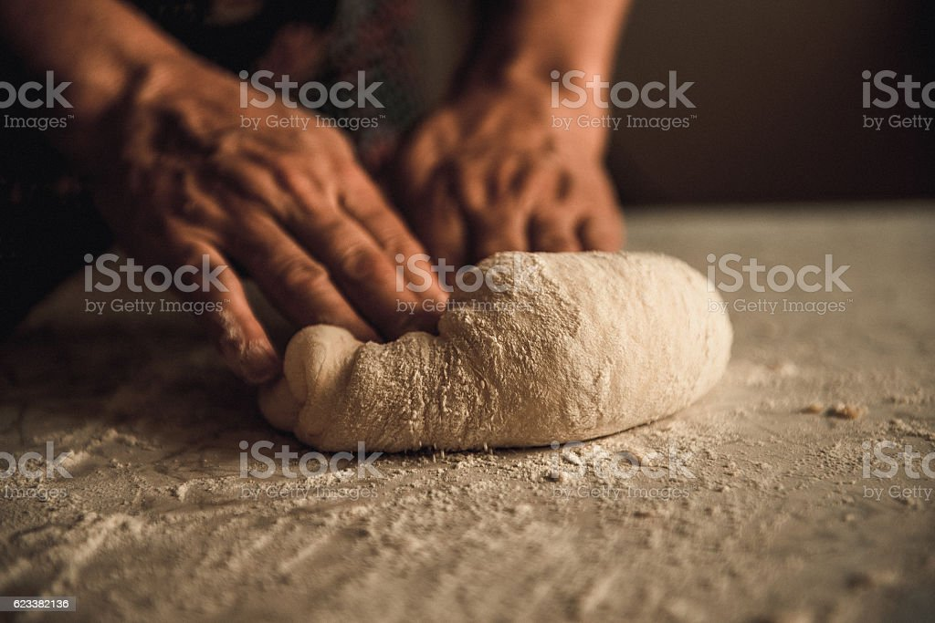 knead the dough by hand stock photo