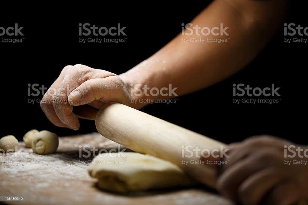 Knead the dough rolling pin hand operation stock photo