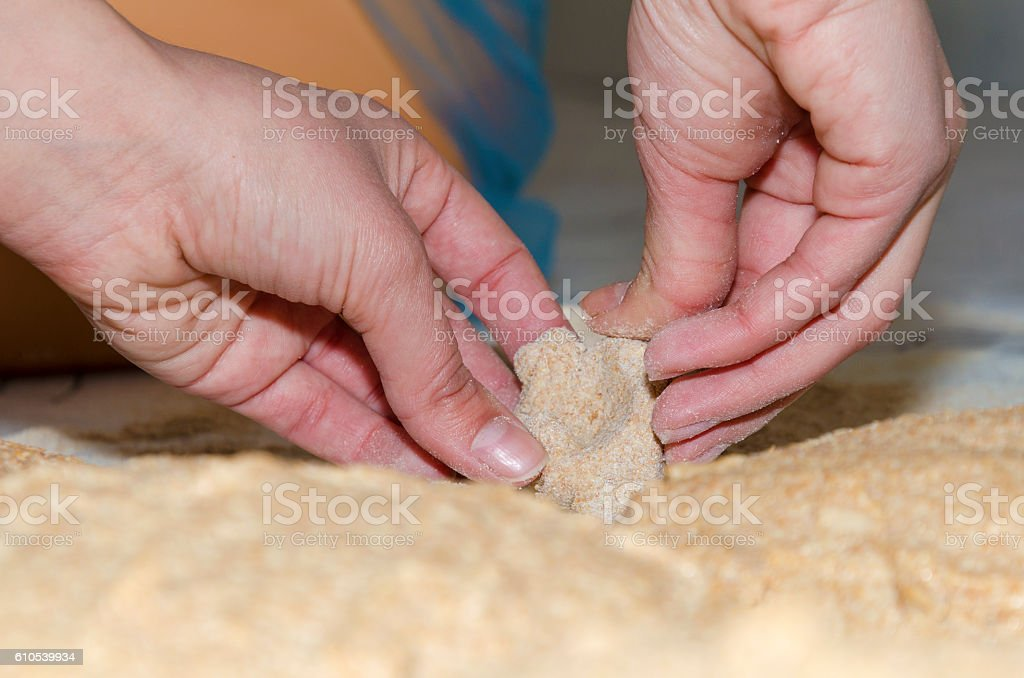 Kneading a dough from Einkorn wheat in a small bakery stock photo