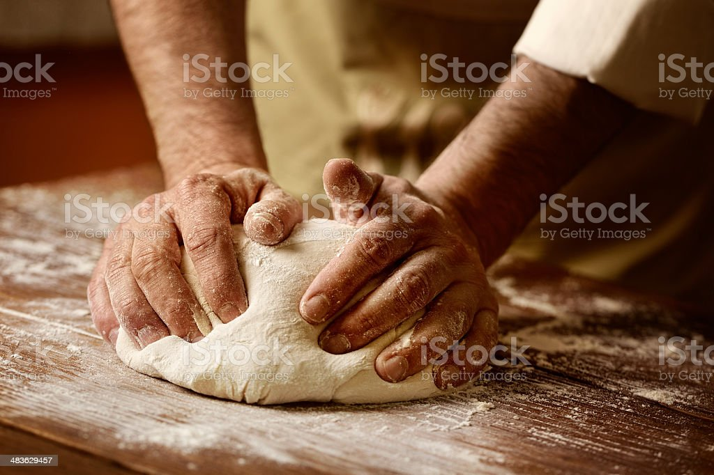 kneading and making yeast dough stock photo