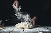 istock Kneading Bread Dough with Hands 1219159360