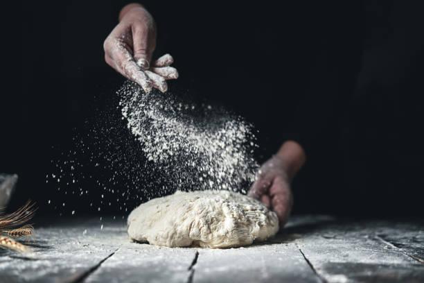 kneading bread dough with hands - baking bread at home imagens e fotografias de stock
