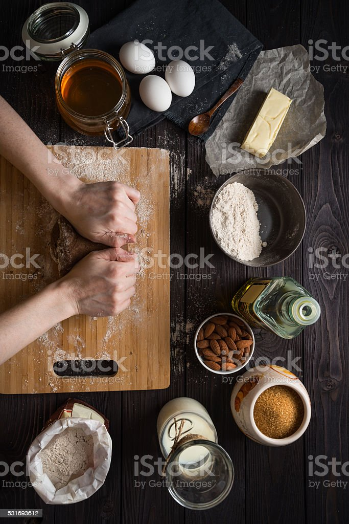 Kneading dough for baking among the ingredients, view from above stock photo