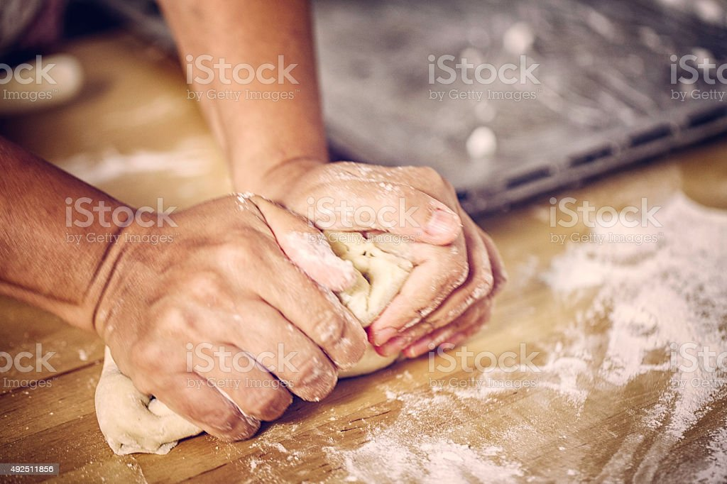 Kneading Dough on the table stock photo