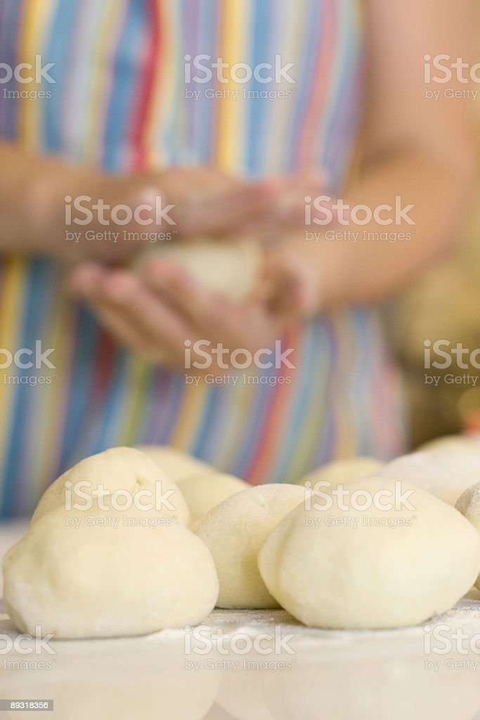 kneading plum dumplings stock photo