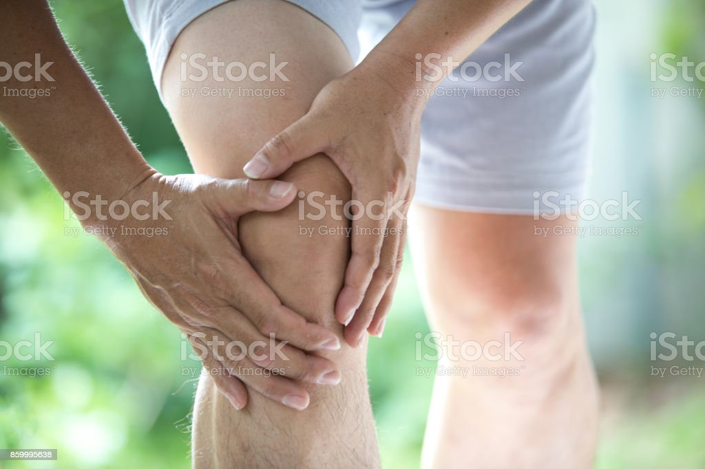 knee ache stock photo