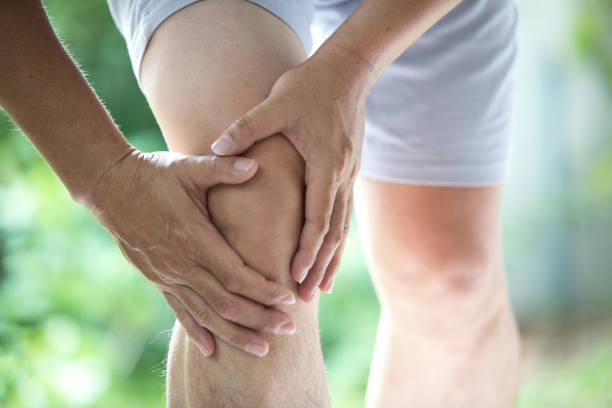 knee ache stock photo