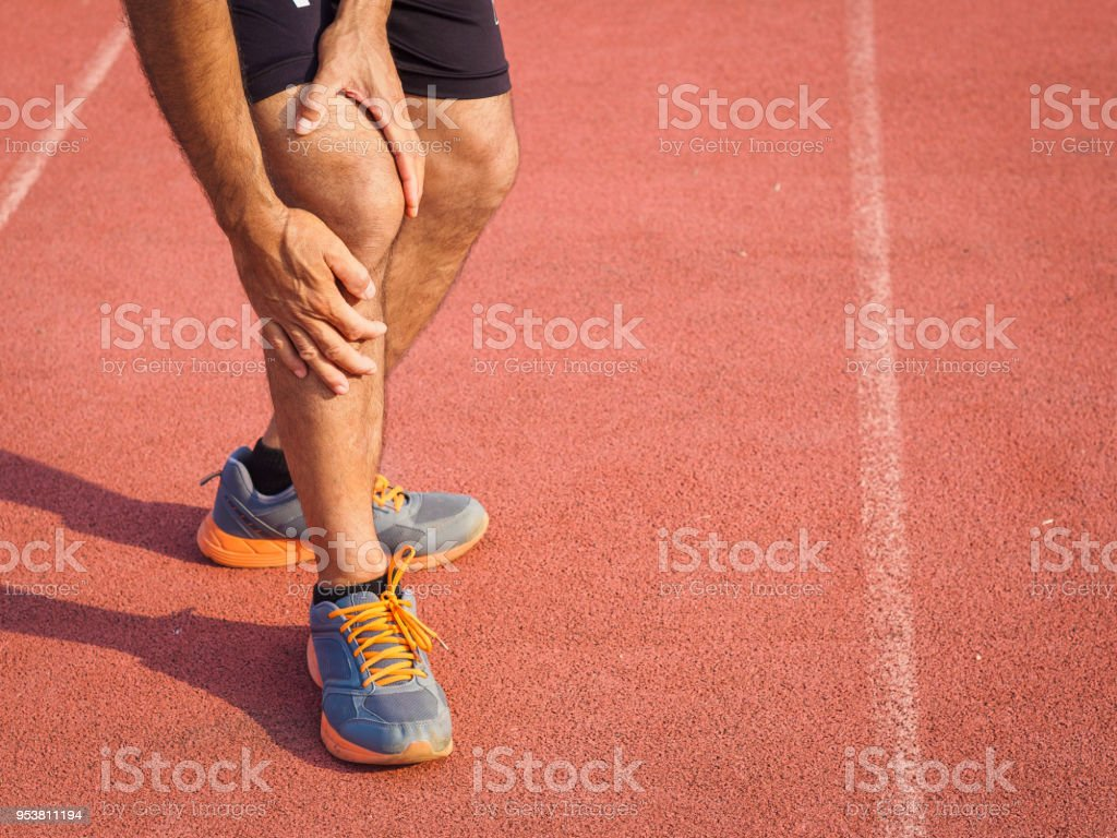 Knee Injuries Sport Man With Strong Athletic Legs Holding Knee With
