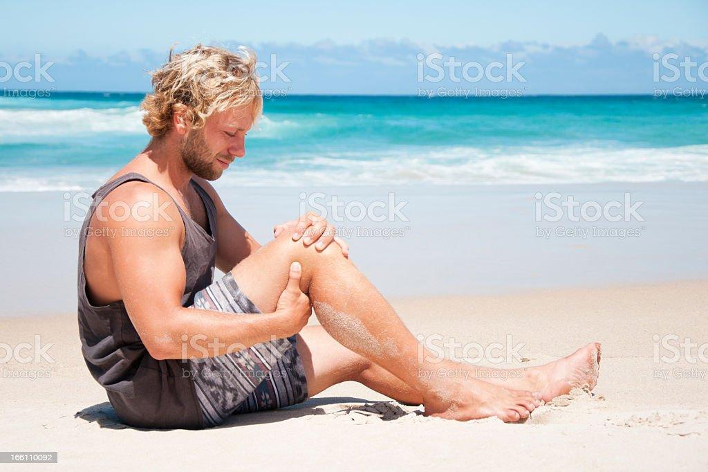Knee Pain at Beach royalty-free stock photo
