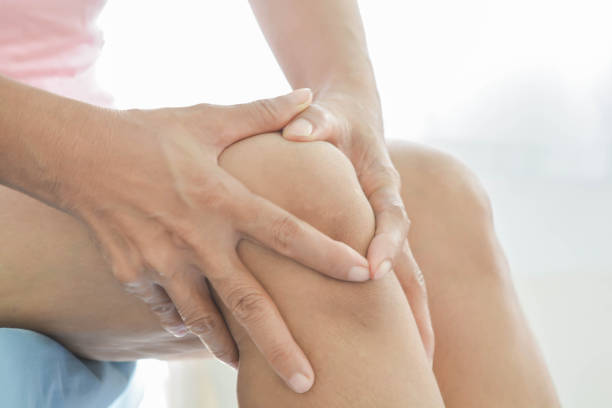 knee  pain in old women stock photo