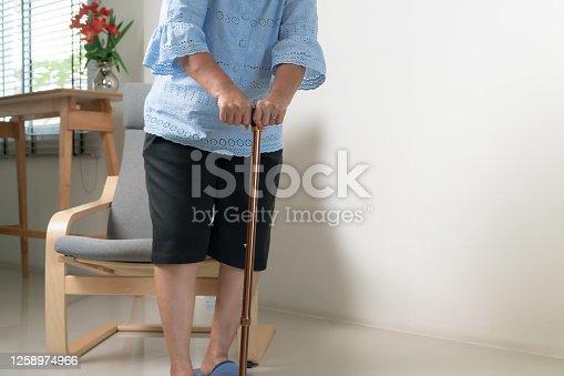 875123630 istock photo Knee pain of senior woman with stick, healthcare problem of senior concept 1258974966
