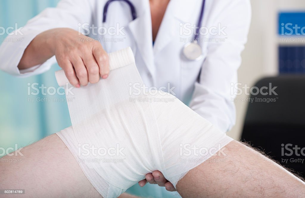 Knee problem at consulting room stock photo