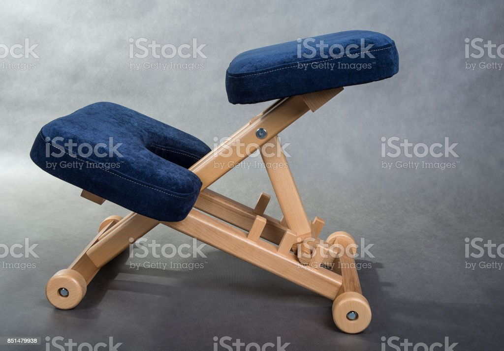 Kneeling chair for healthy sitting. Knee chair support your back. stock photo