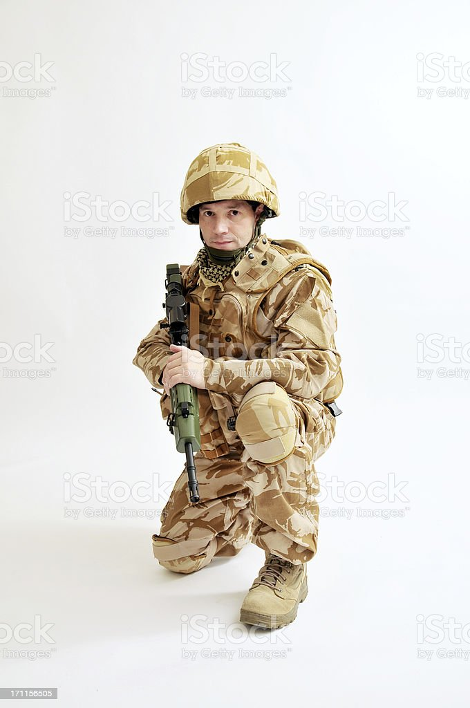 Kneeling Soldier With Rifle royalty-free stock photo