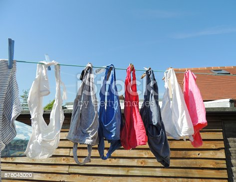 Women's underwear hanging out to dry on the washing line.