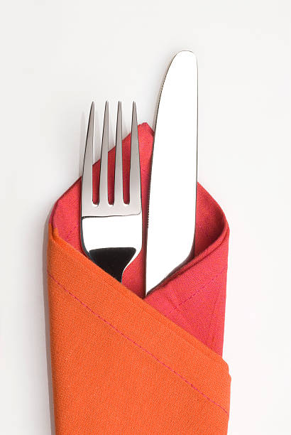 knife and fork in a napkin - table knife stock photos and pictures