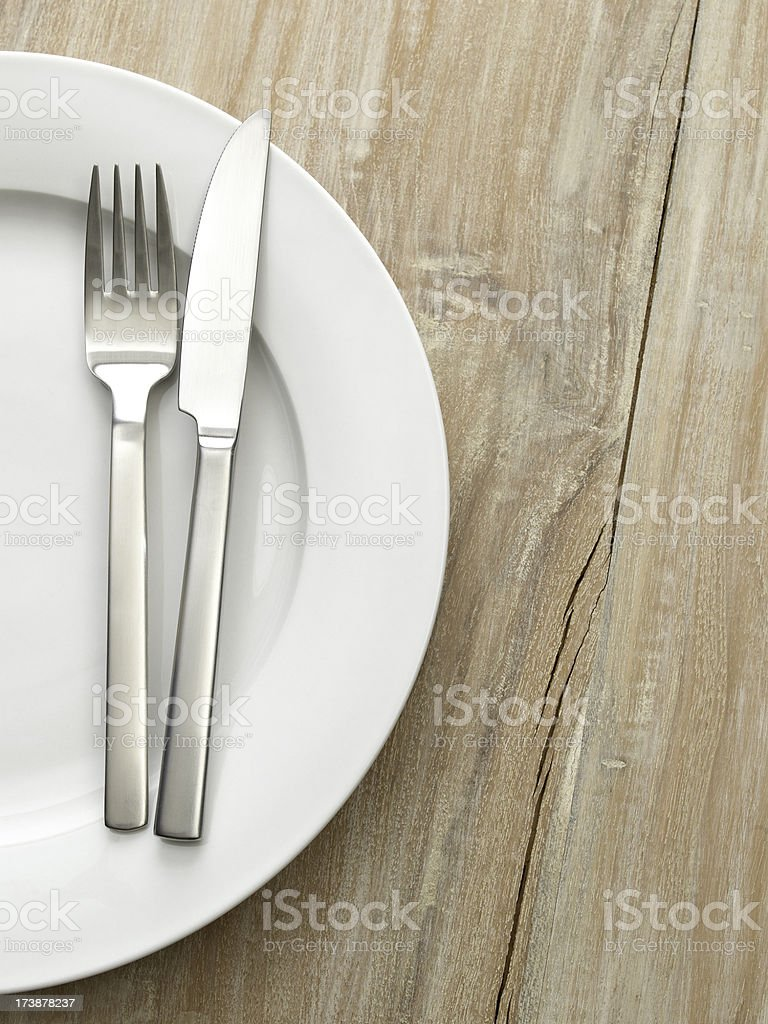 knife and fork on old tabletop royalty-free stock photo