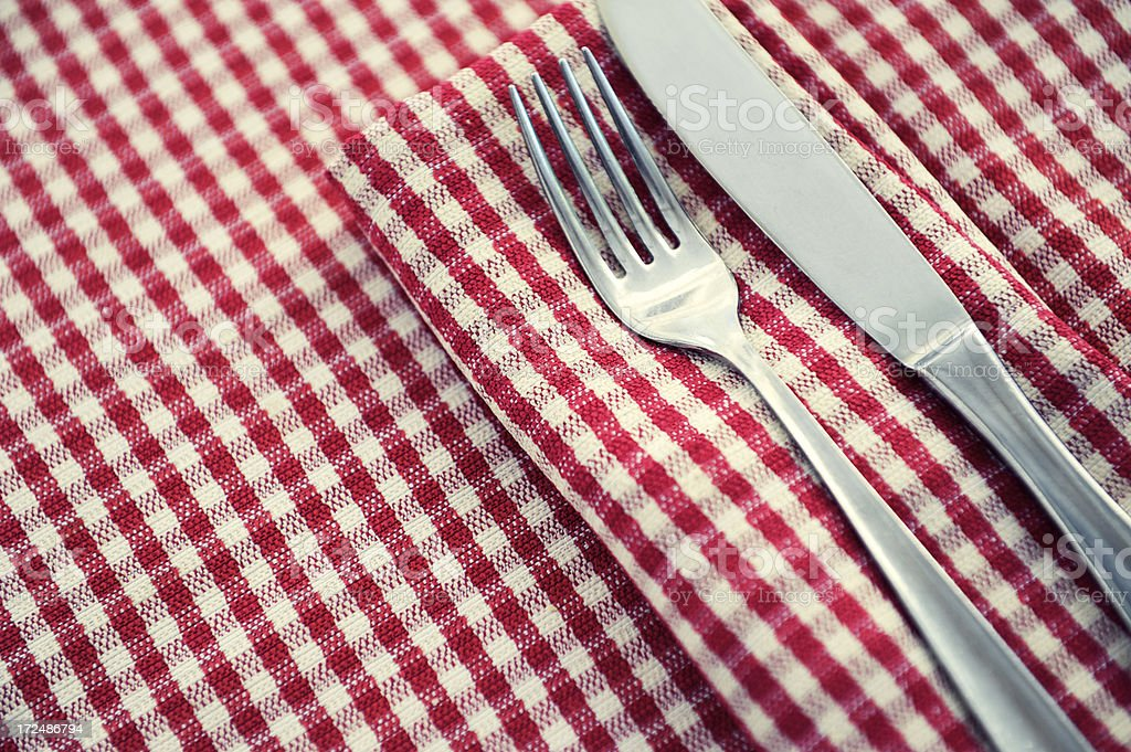 Knife And Fork On Traditional Italian Red Checkered Tablecloth Royalty Free  Stock Photo