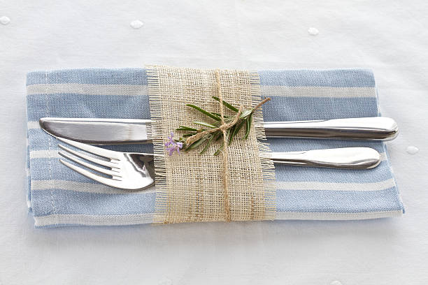 knife and fork with napkin - blue table setting stock photos and pictures