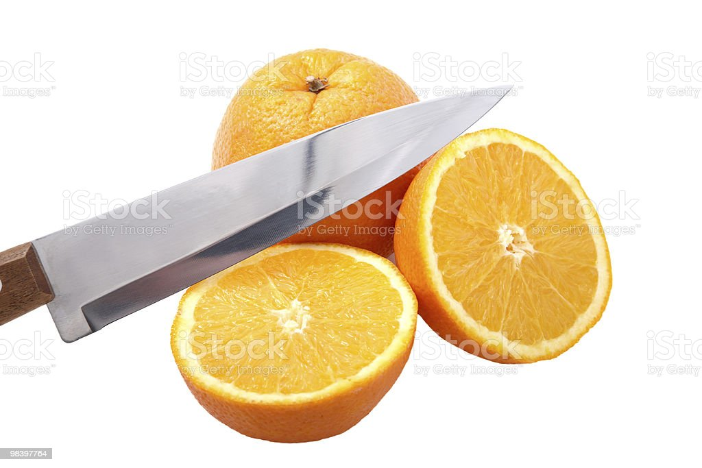Knife and orange cut half-and-half royalty-free stock photo