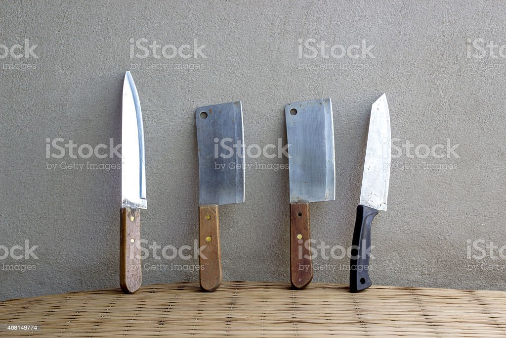 knife cooking set still life on mat weave and concrete stock photo