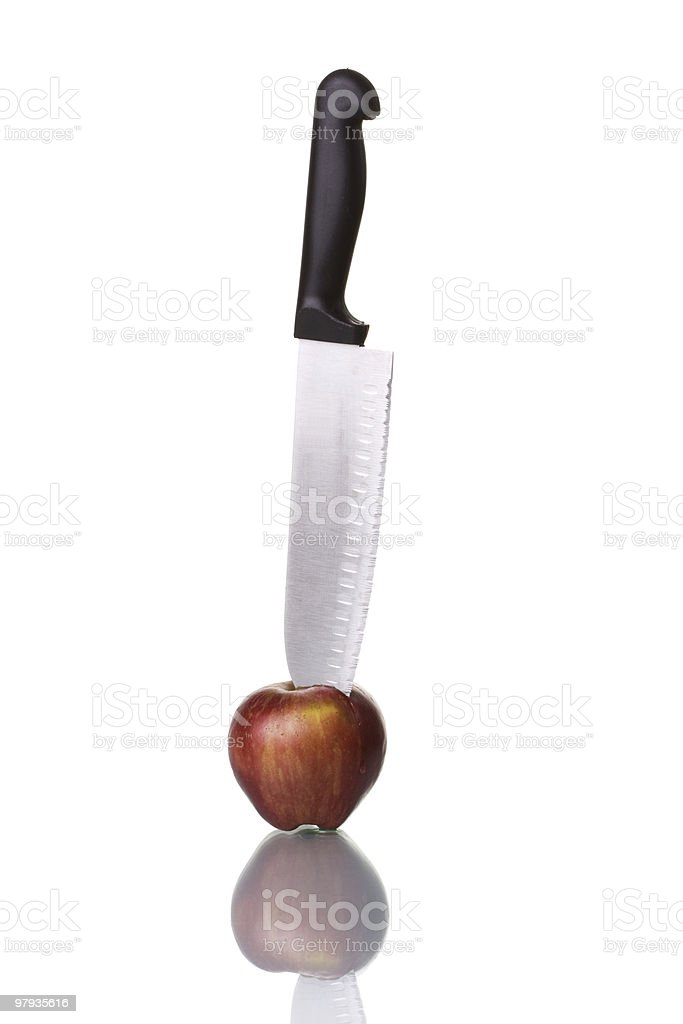 Knife cutting an apple royalty-free stock photo