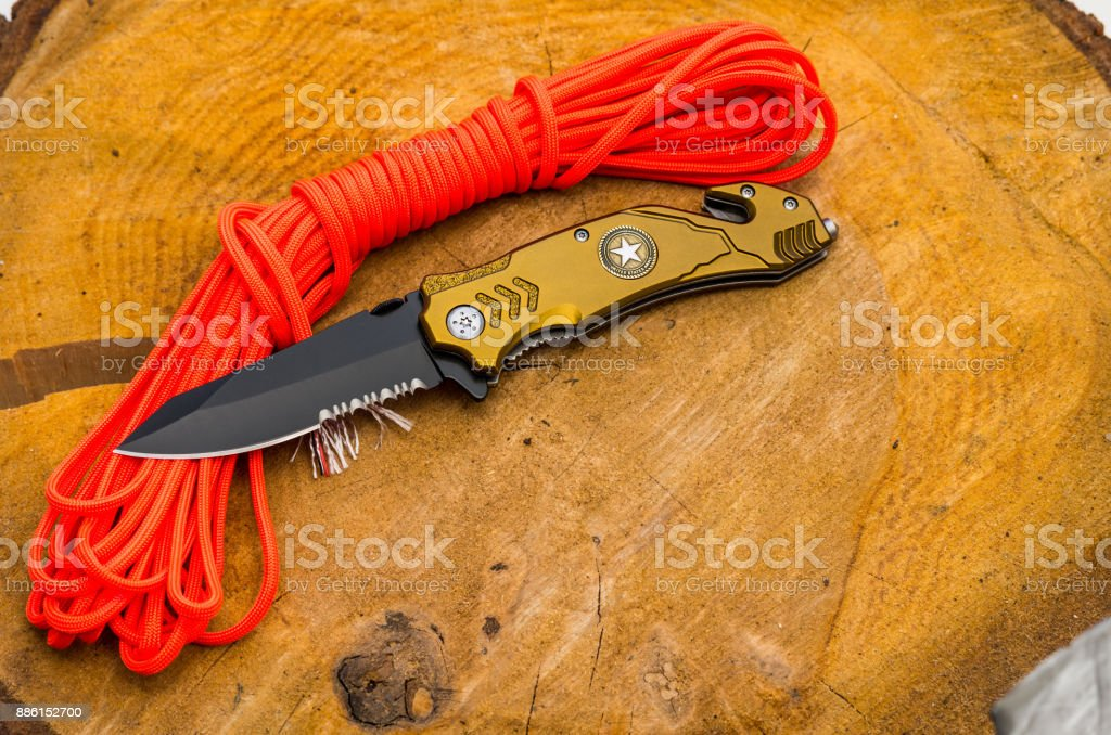 Knife for everyday carrying. Knife with tools for survival. stock photo
