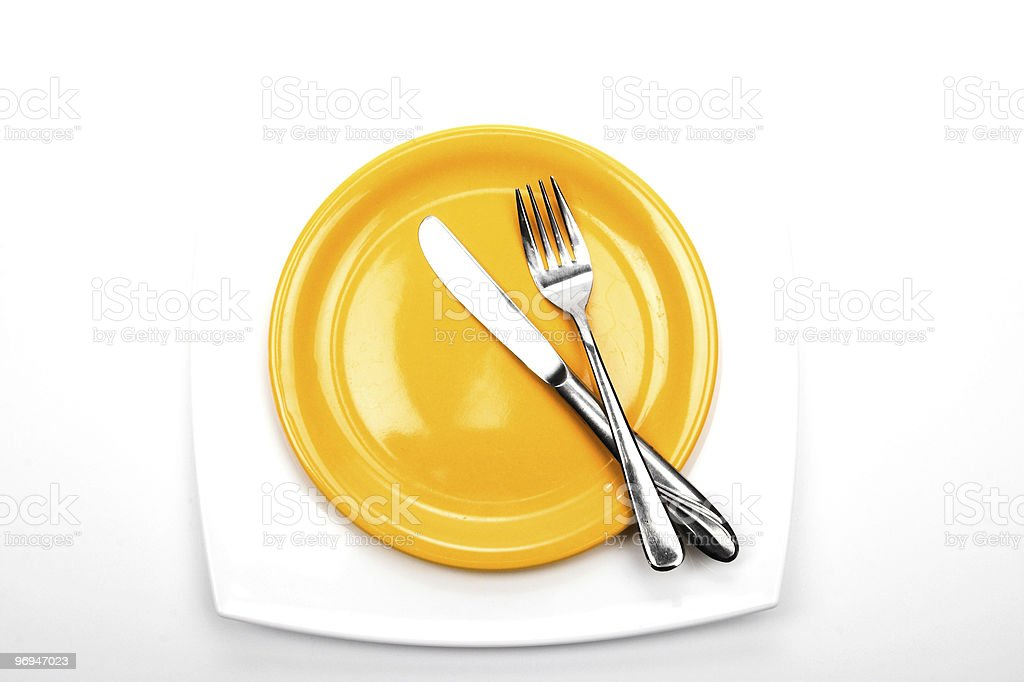 Knife,  fork and plates royalty-free stock photo