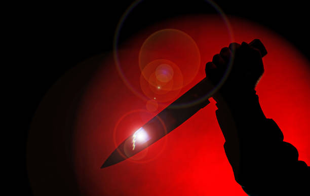 knife in darkness - killer stock pictures, royalty-free photos & images
