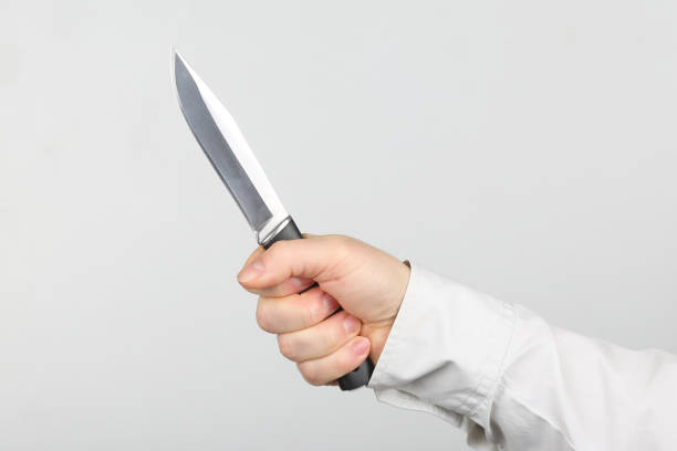 knife in the hands of a man stock photo