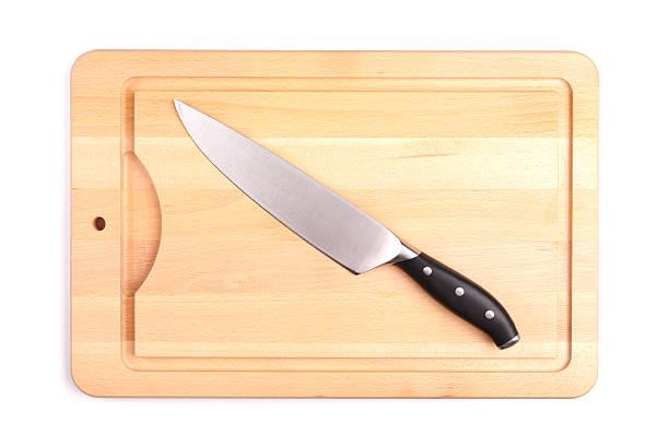 Messer auf Schneidebrett – Foto