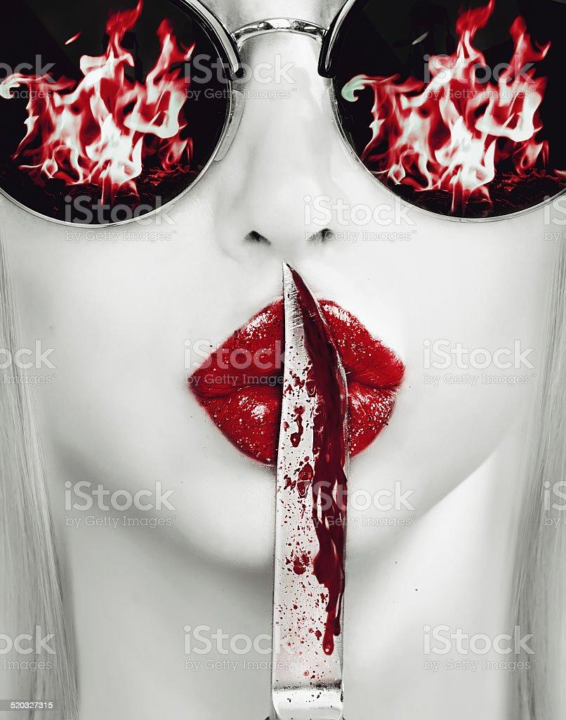 knife on lips stock photo