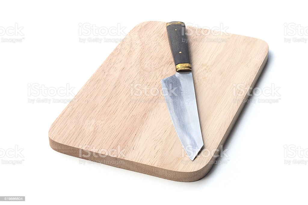 knife on wood plate stock photo
