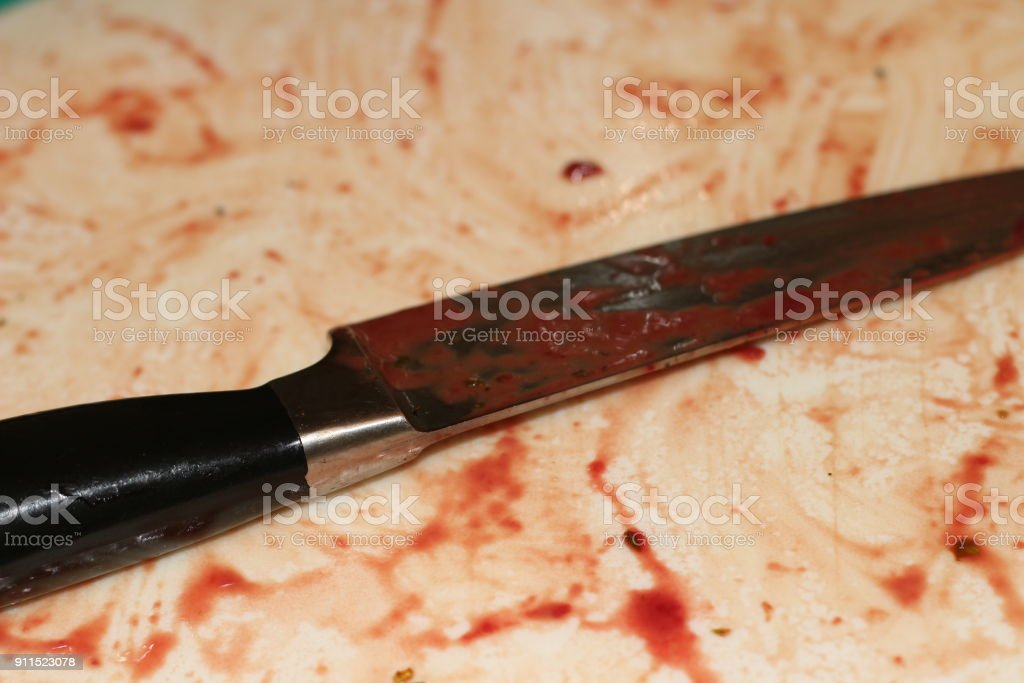 knife over cutting board stock photo
